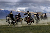 A group of Changpa horsemen riding a race near lake Tso Moriri. The races are infrequent.
