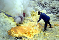 Volcanic gases channelized through network of ceramic pipes come out as molten sulphur.