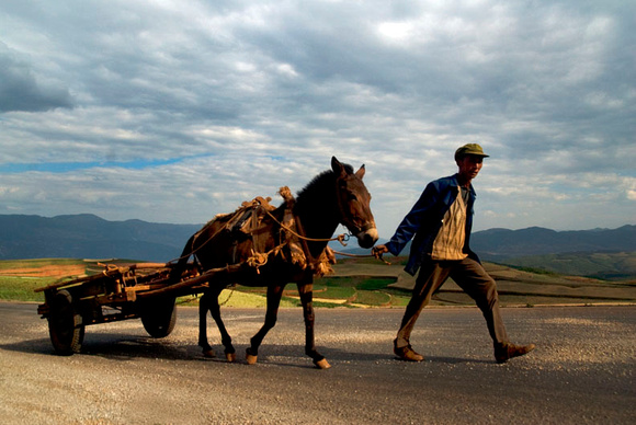 5. A Dongchuan peasant returns home with his horse