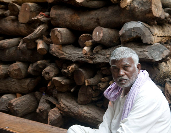 Madhu hails from the Yadav community and partners the doms in the firewood trade in Manikarnika. But he says that he cannot touch or eat with the doms as it will render him an outcast in his community