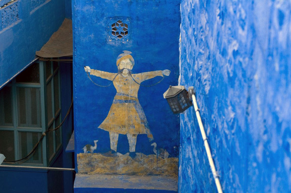 Wall painting on a blue house