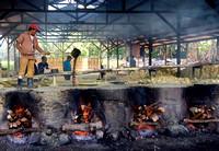 Handmade clay ovens and are being used to melt the sulphur chunks into liquid sulphur